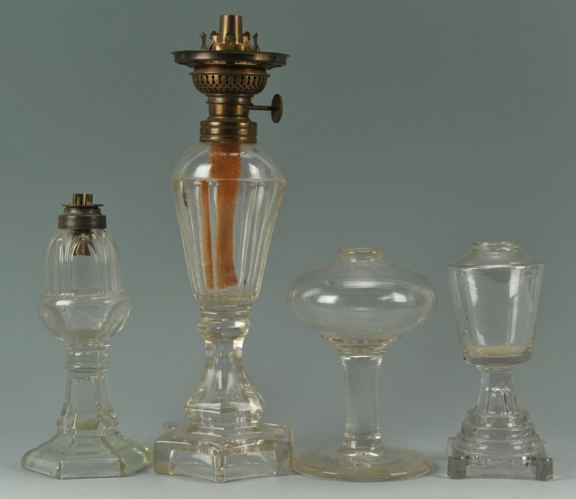 Lot 659: 4 Colorless Glass Whale Oil Lamps