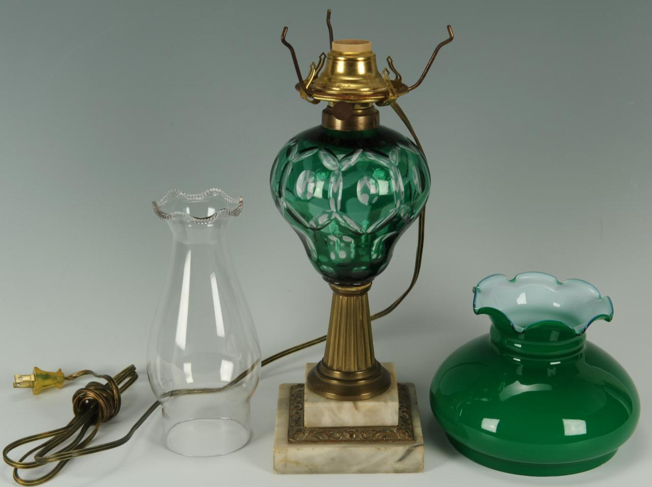 Lot 661: 2 Overlay Cut Glass Oil Lamps