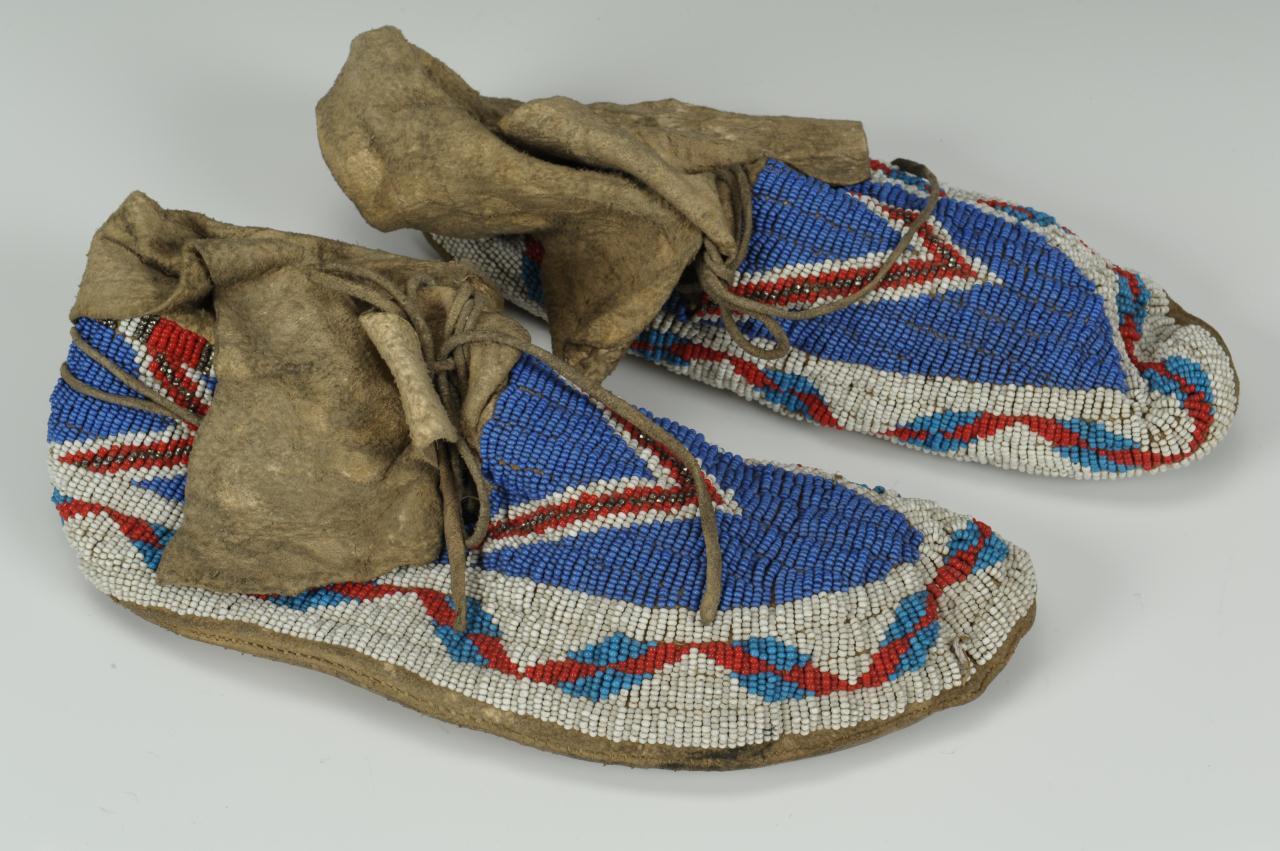 Lot 683: Pair Plains Native American Hide Moccasins