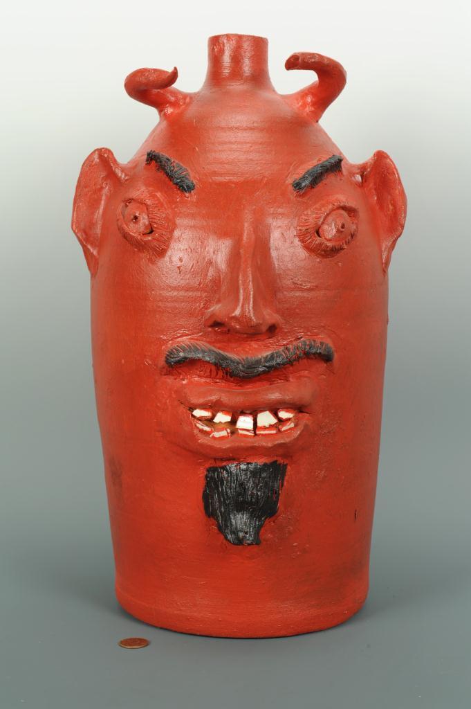 Lot 689: NC Folk Pottery Devil Face Jug, Browns Pottery