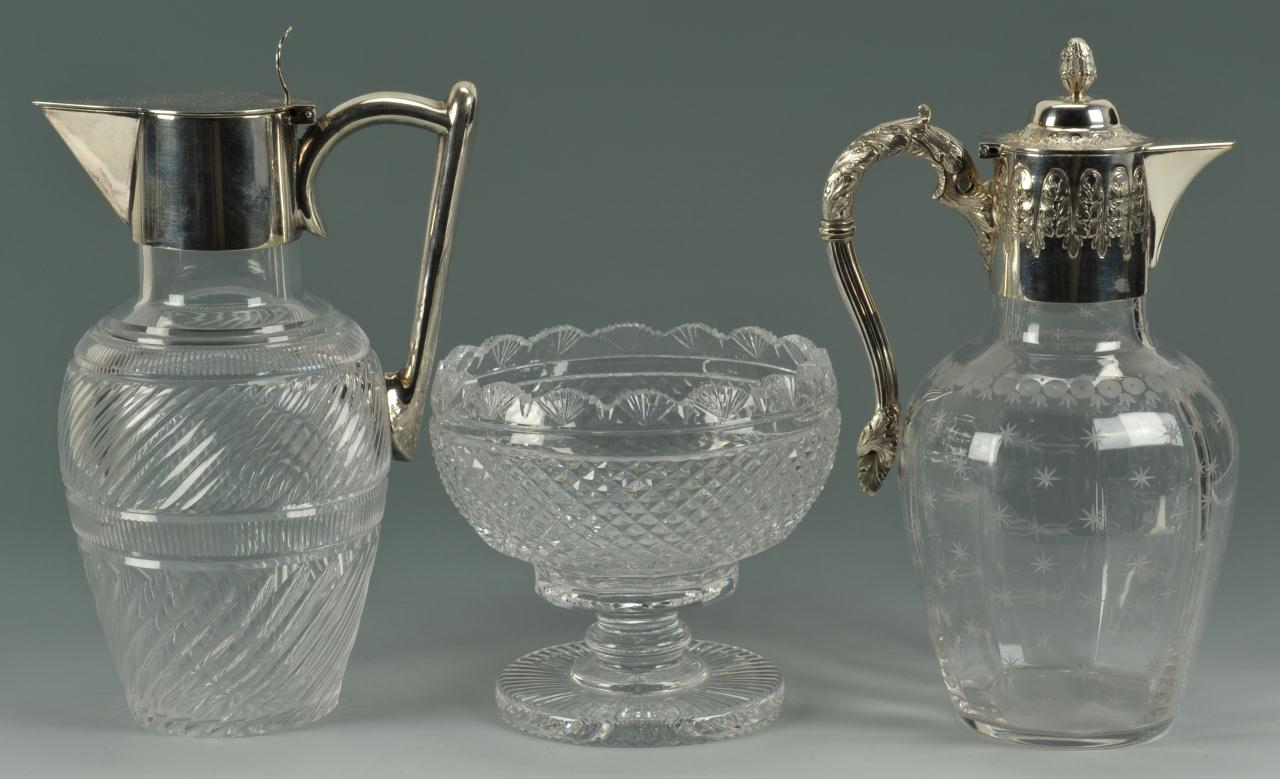 Lot 714: 2 crystal and silverplated claret jugs and a bowl
