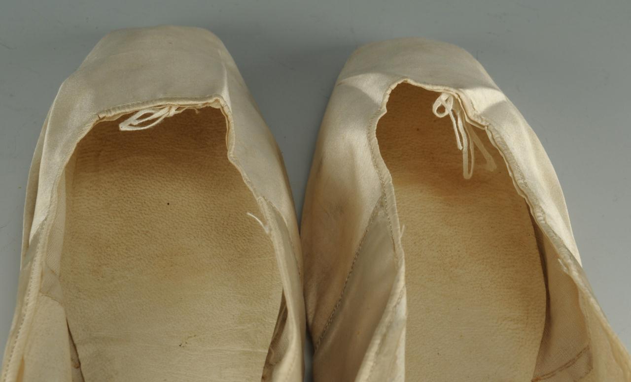 Lot 722: Pair of 19th century silk wedding slippers