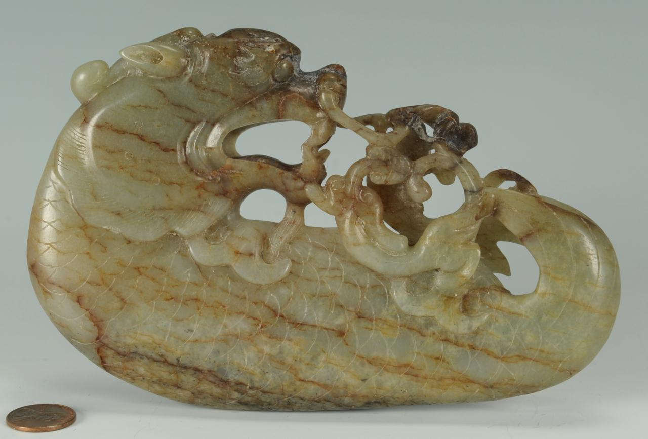 Lot 8: Finely carved Chinese Celadon and Russet jade drag