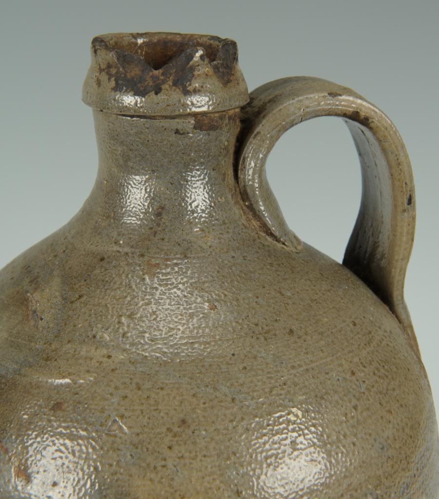 "Lot 99: NC Stoneware Pottery Jug, stamped ""Craven"""