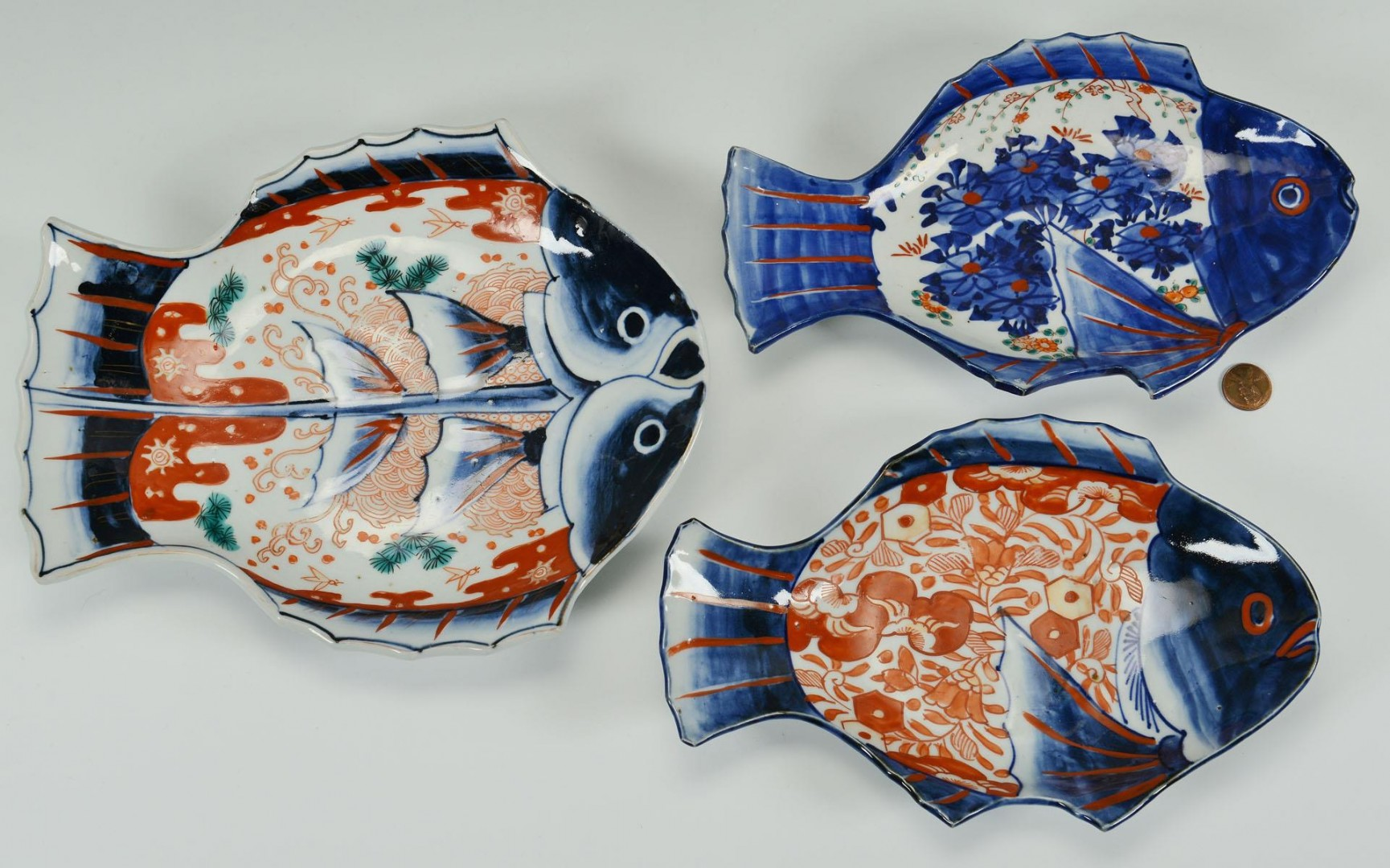 Lot 238: Three Japanese Imari Fish platters, 1 double