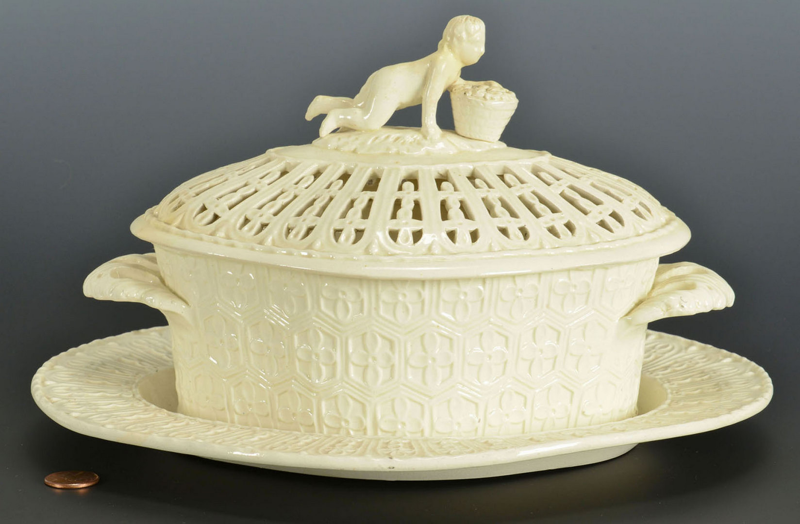 Lot 247: Creamware covered basket with figural knob