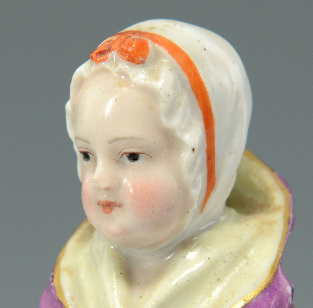 Lot 250: Small Meissen Figurine, girl with muff