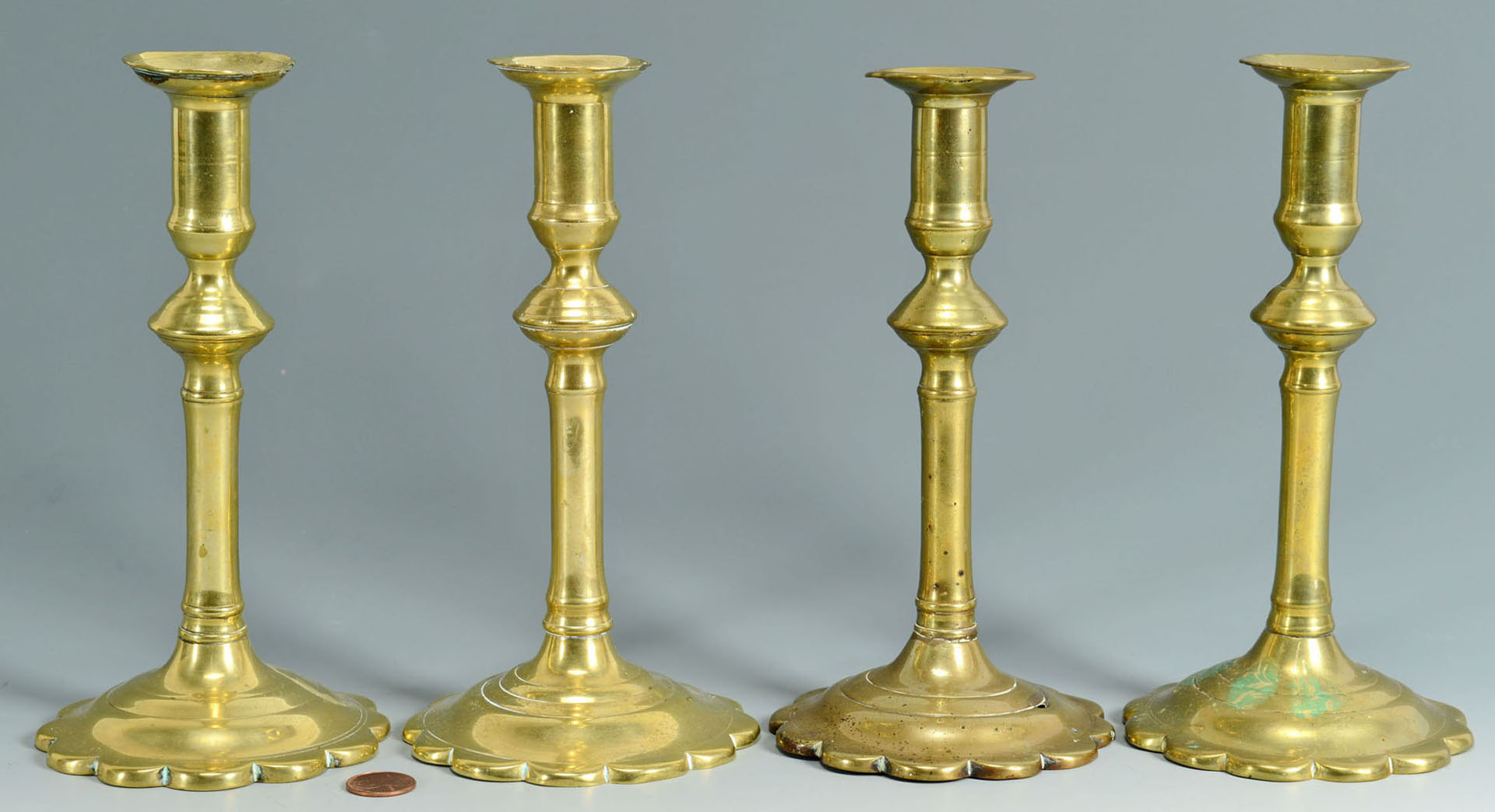 Lot 251: Group of 4 Queen Anne 18th c. Brass Candlesticks