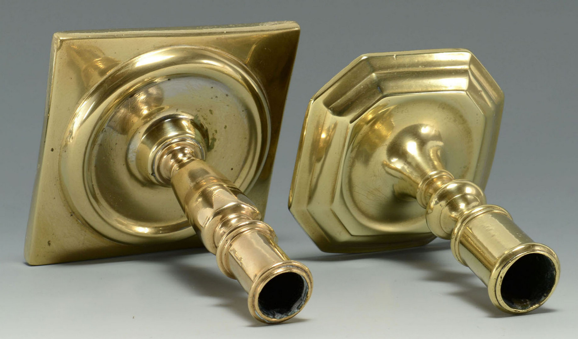 Lot 252: Four Brass Candlesticks of various forms
