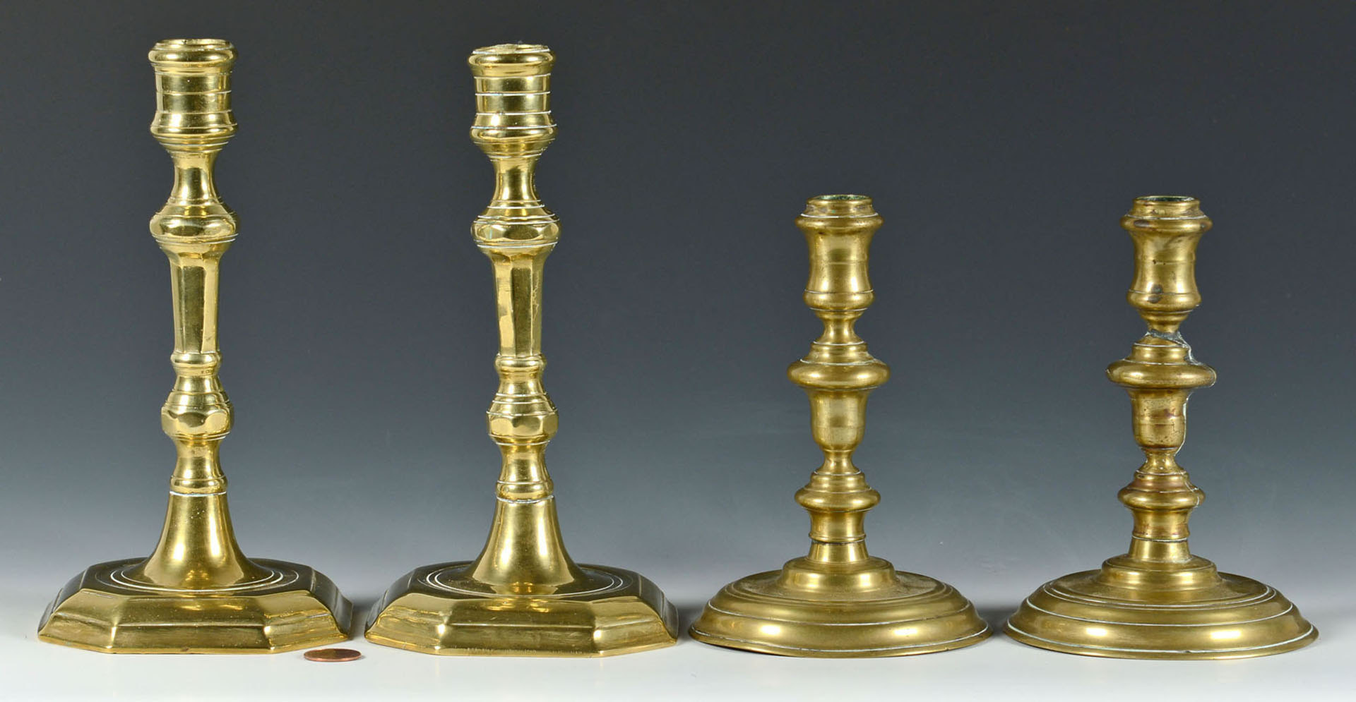 Lot 253: Four English Brass 18th c Candlesticks