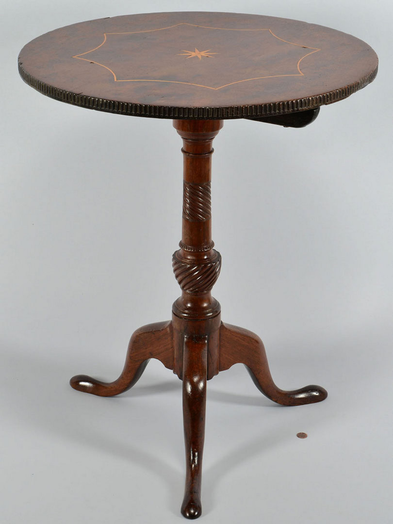 Lot 257: Tilt top table with star inlay