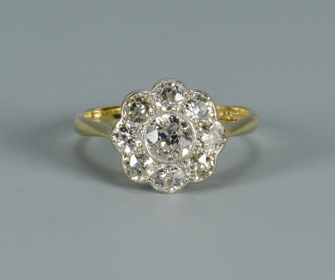 Lot 280: 18k gold and platinum Diamond Cluster Ring