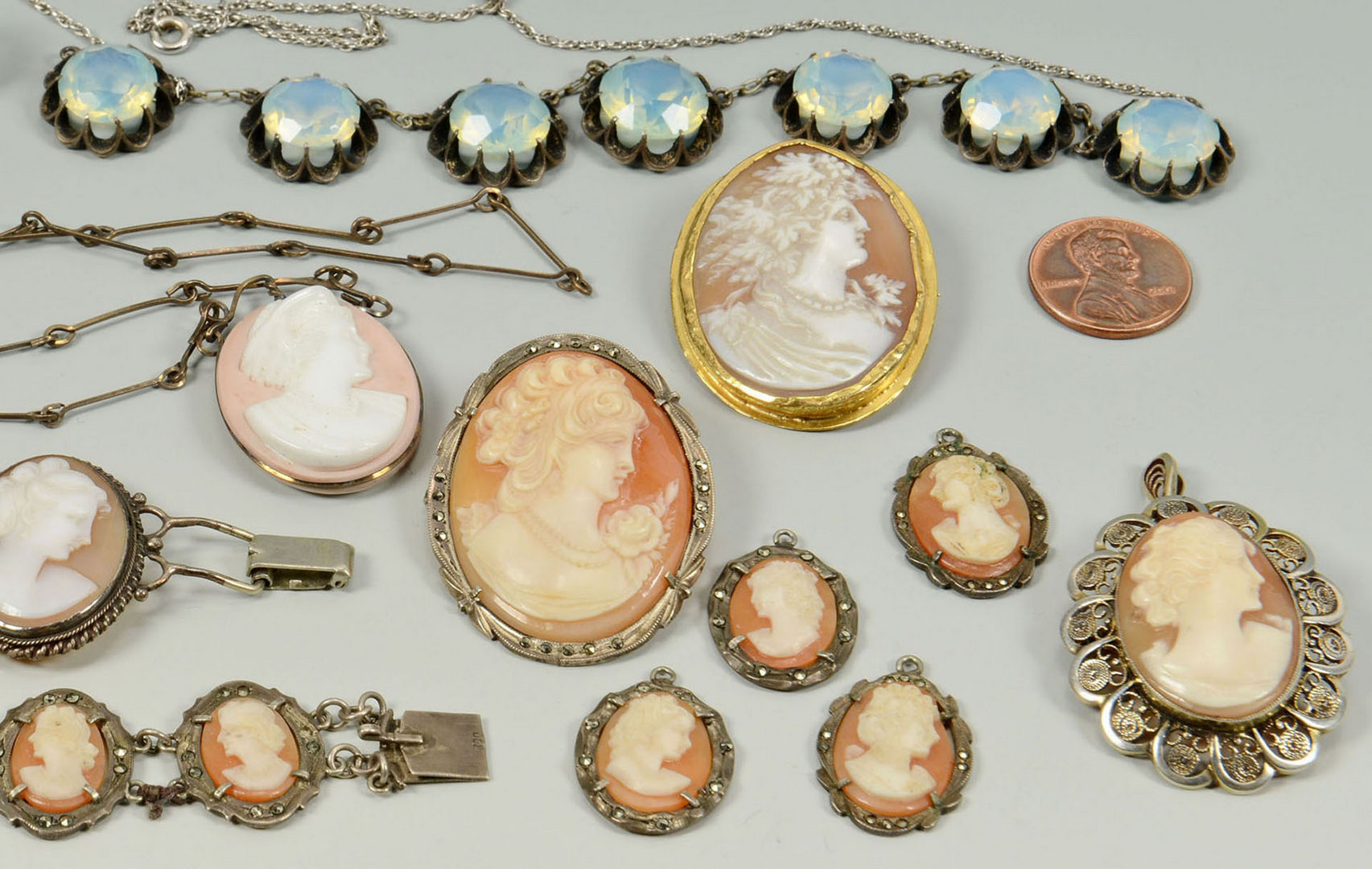 Lot 291: 16 items cameo, moonstone, and mother of pearl jew