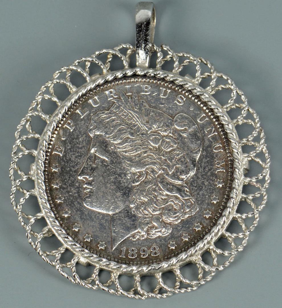 Lot 292: 2 coin pendants: Gold Liberty $5 & Morgan dollar
