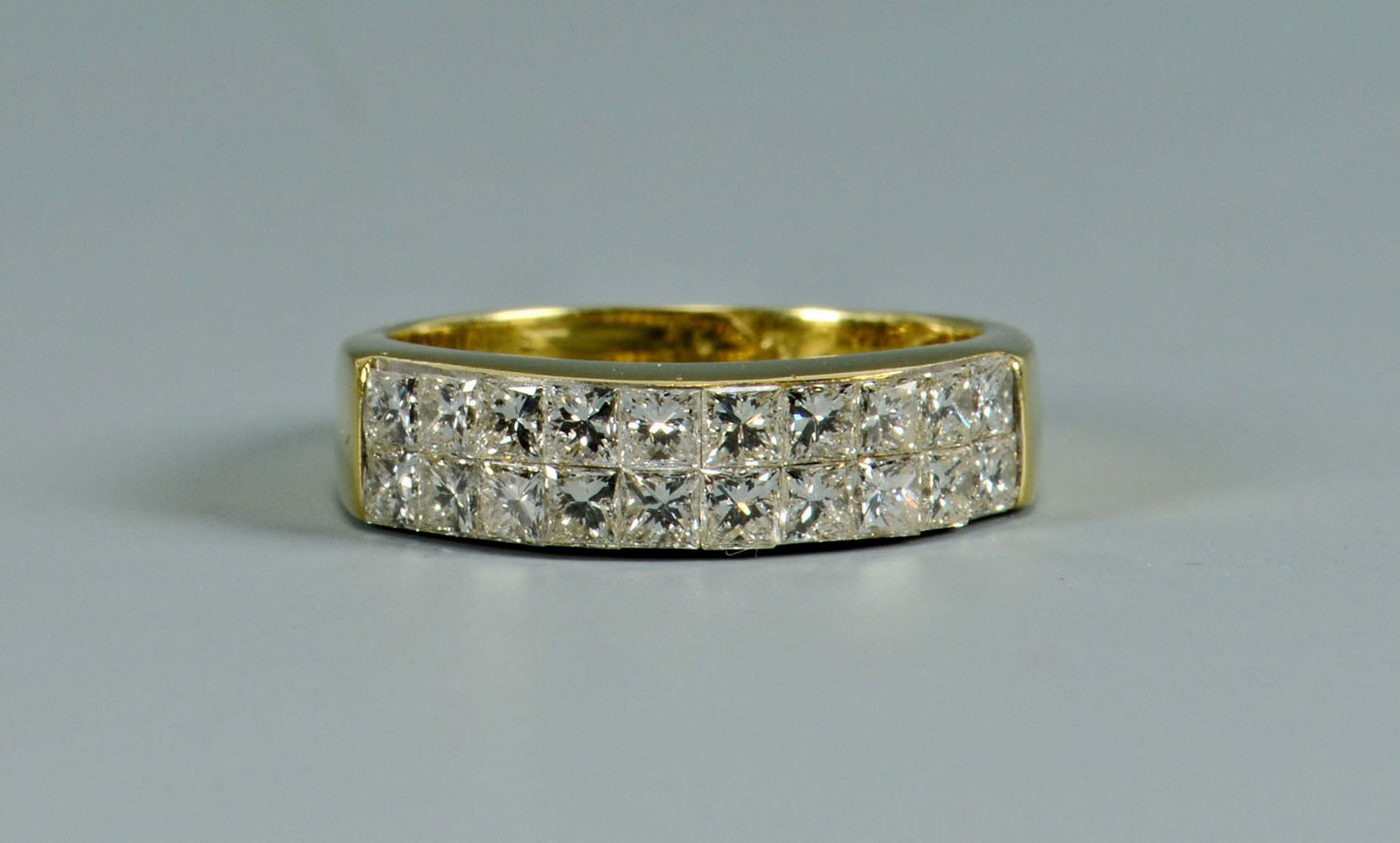 Lot 296: 18k Radiant Diamond Band