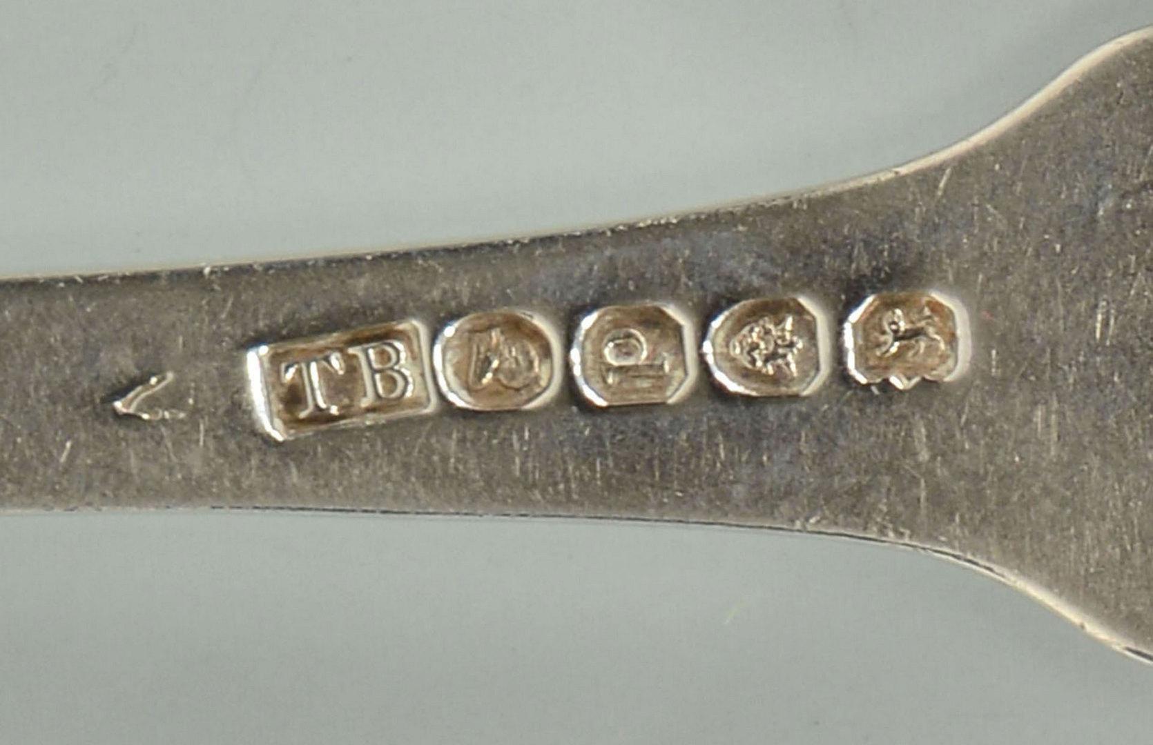 Lot 299: 4 pieces Geo. III shell pattern flatware, T. Baker
