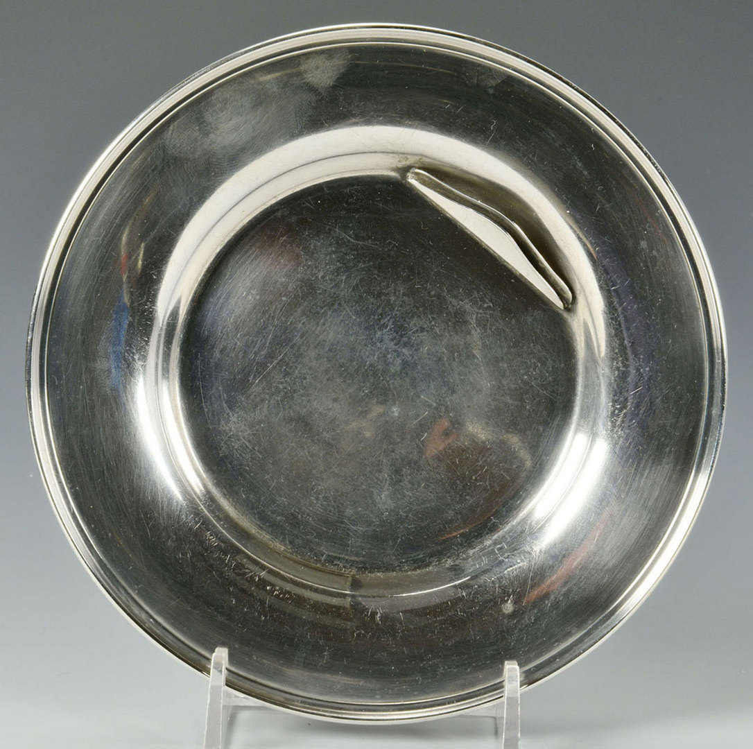 Lot 307: 13 Sterling silver butter plates