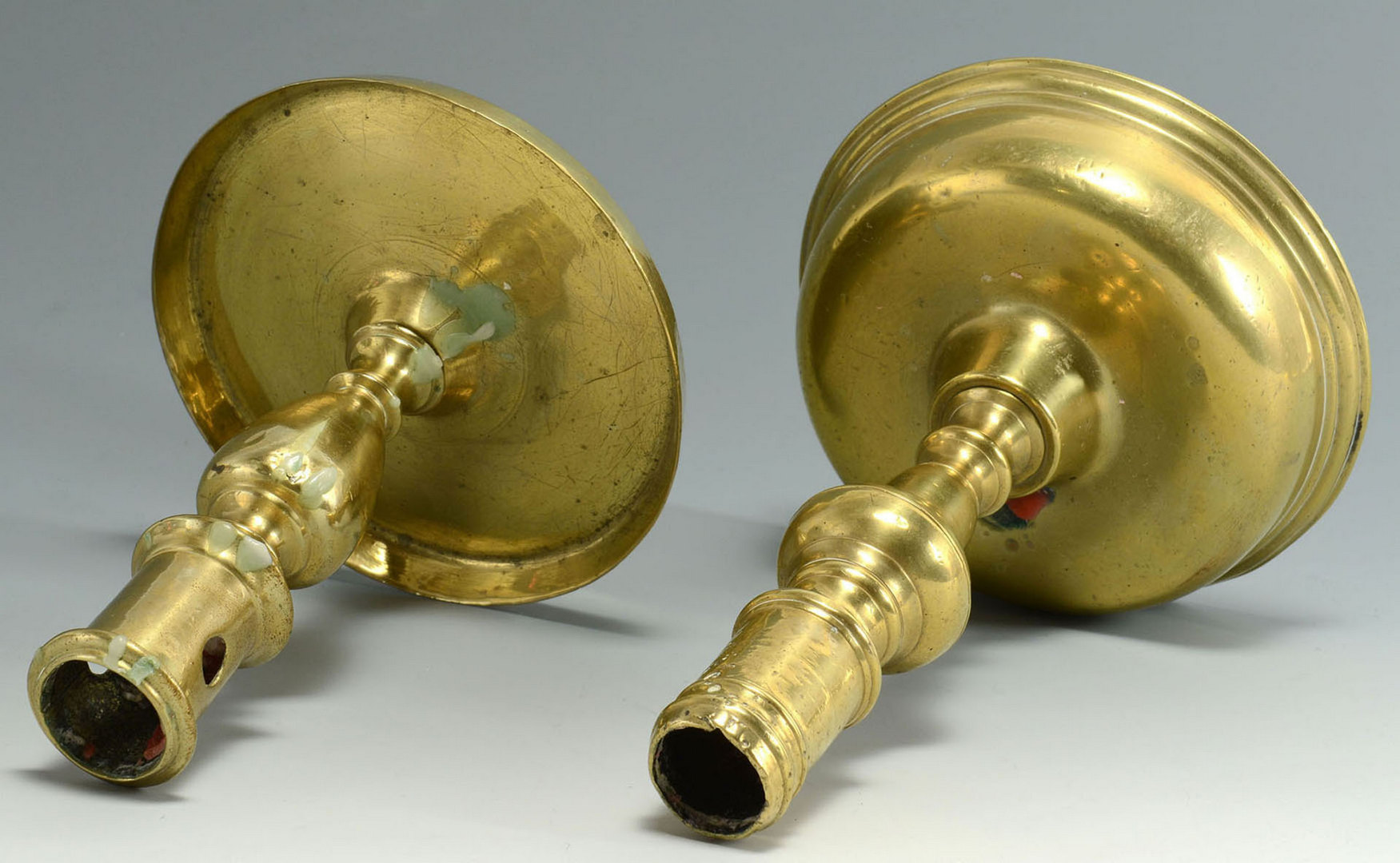 Lot 32: Four 17th c. English Brass Candlesticks