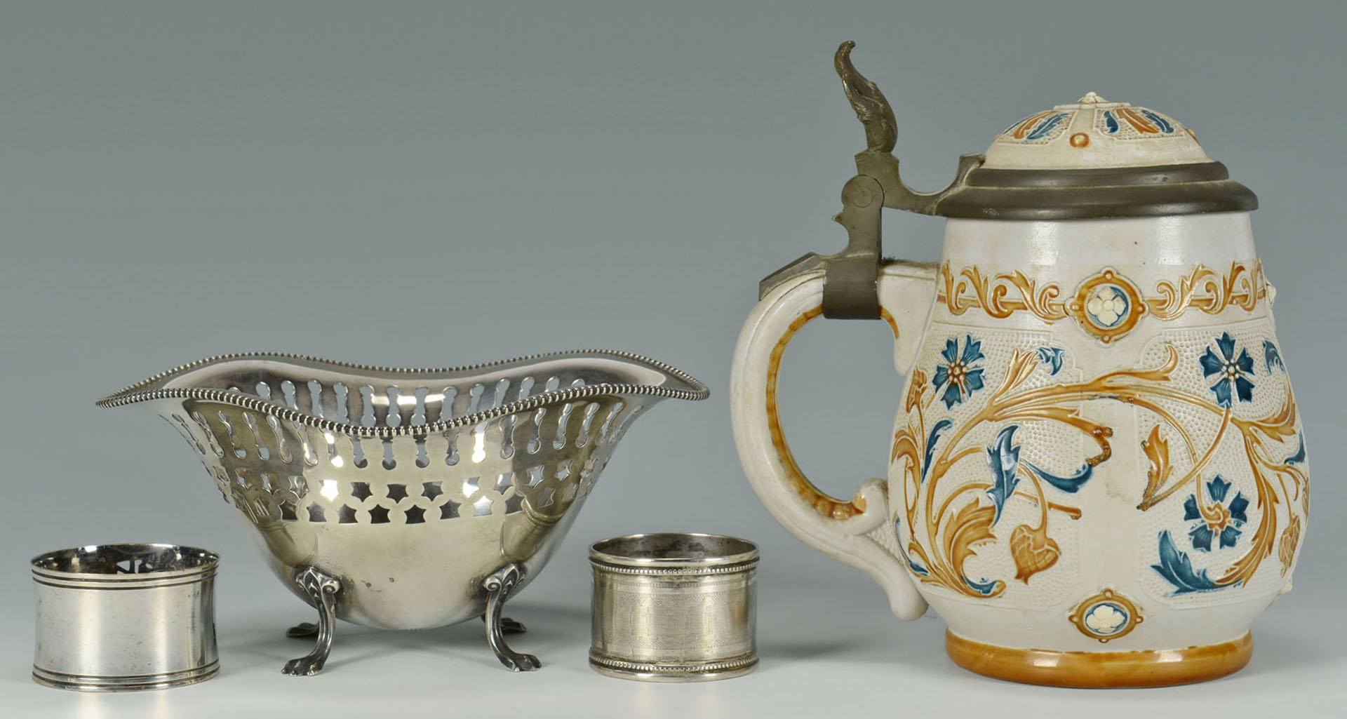 Lot 471: Mettlach Stein and 4 pcs assorted silver