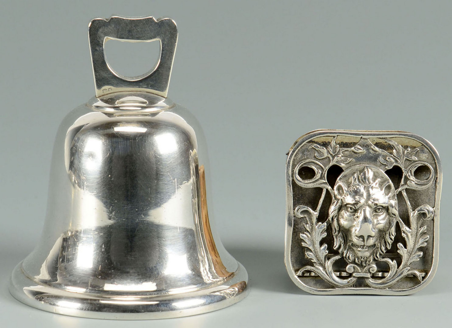 Lot 487: Silver trivets, bell and clip, 4 items