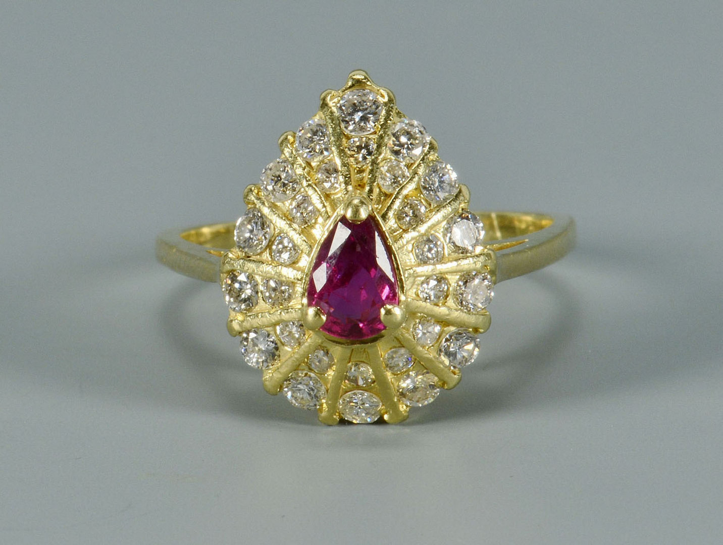 Lot 491: 18k Pear-shaped Ruby and Diamond Ring