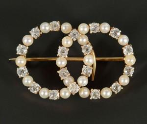 Lot 498: 14k Double Circle Diamond & Pearl Pin