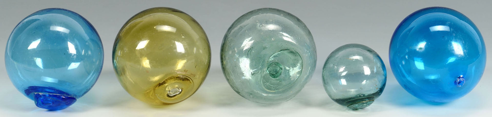 Lot 515: Group of 7 Colored Blown Glass Whimsy Balls