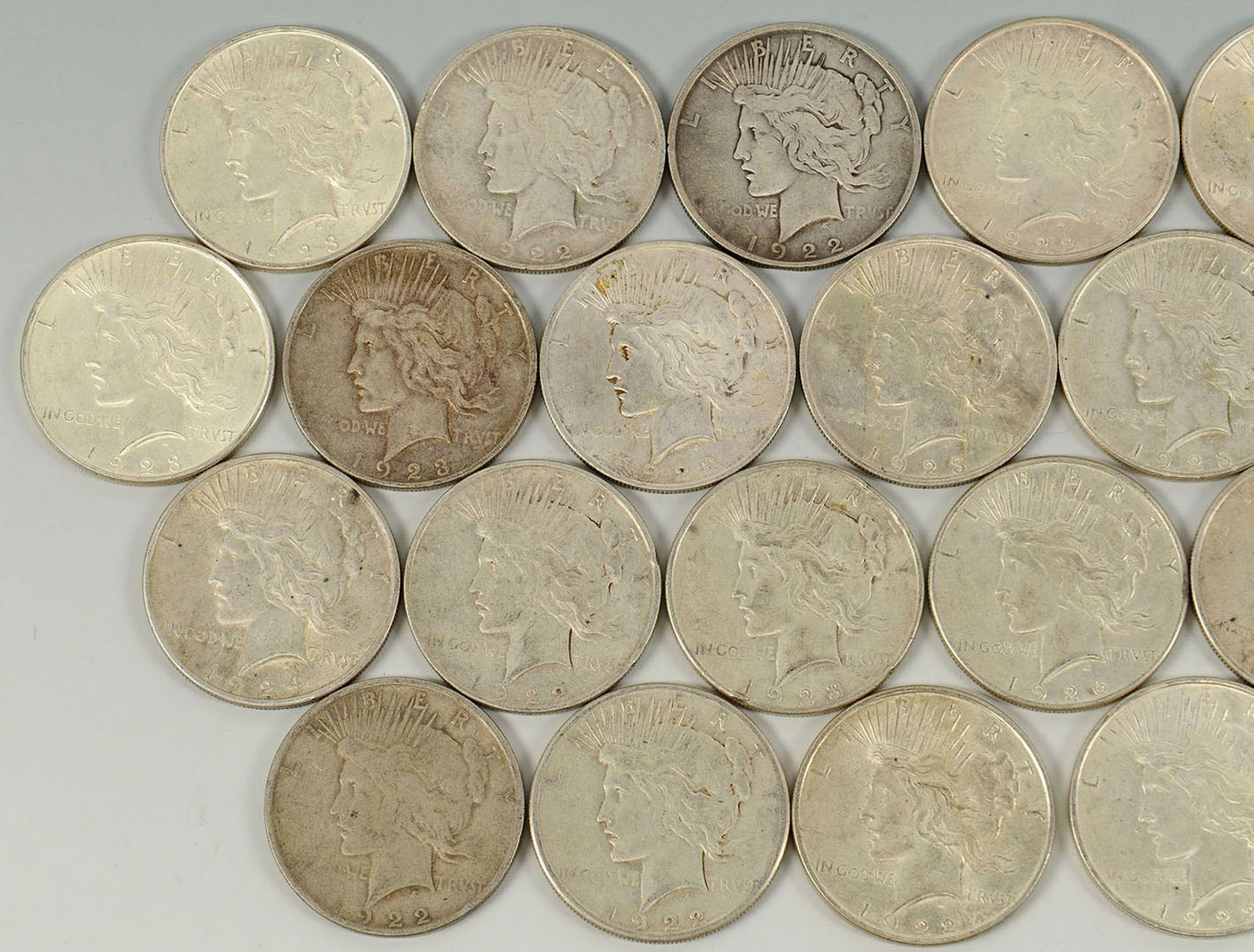 Lot 526: Grouping of 28 Peace Silver Dollars