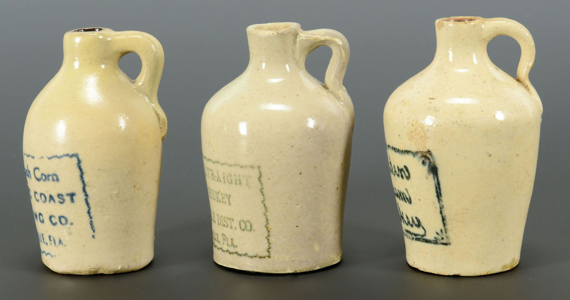 Lot 548: Florida and Alabama Miniature Whiskey Jugs, 3