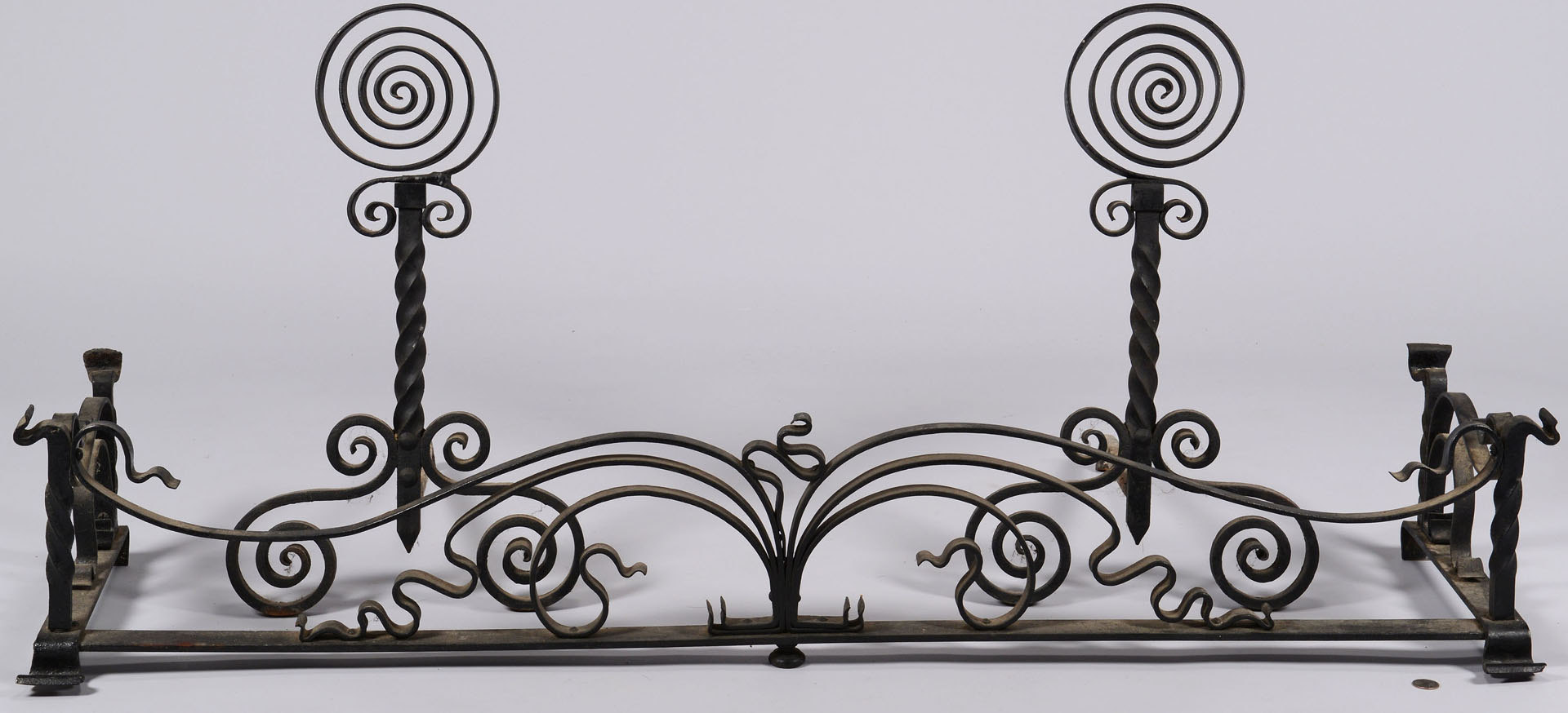 Lot 581: Iron Fireplace Fender & Andirons, poss. Yellin