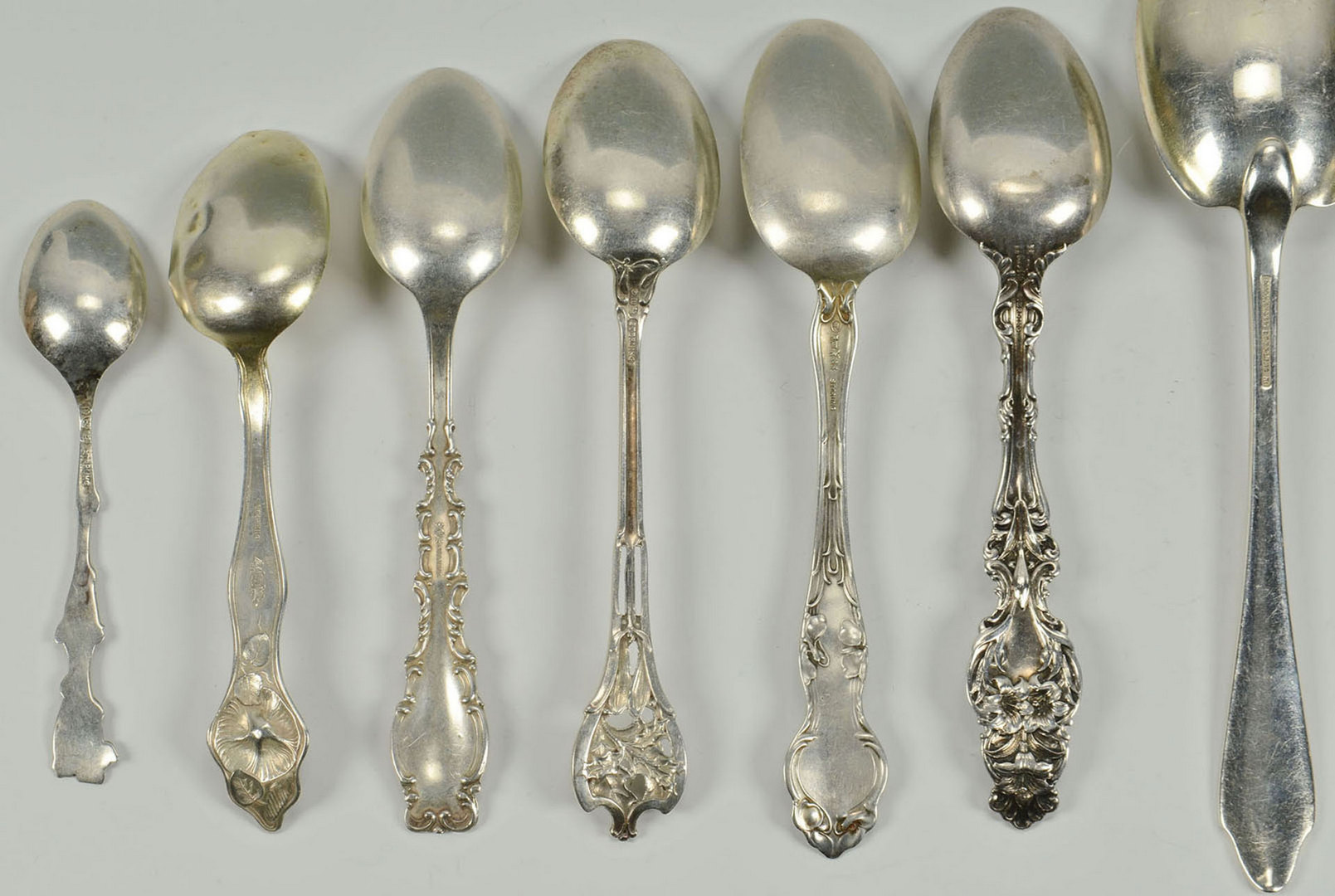 lot 592  13 sterling silver spoons incl tiffany serving spo