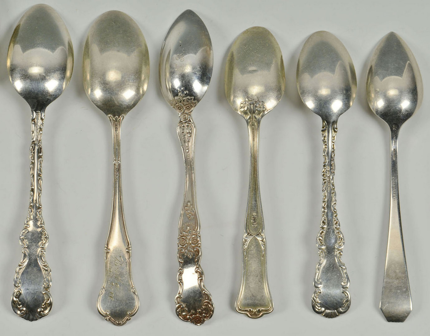Lot 592: 13 Sterling Silver Spoons incl Tiffany serving spo