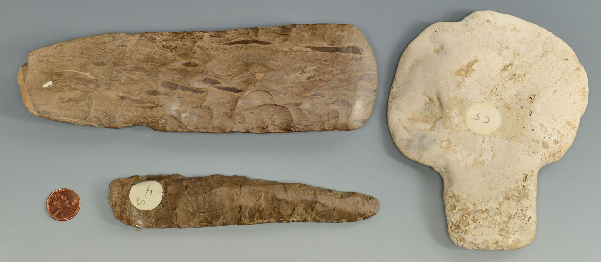 Lot 636: 2 Dover flint celts and 1 spatulate celt, TN