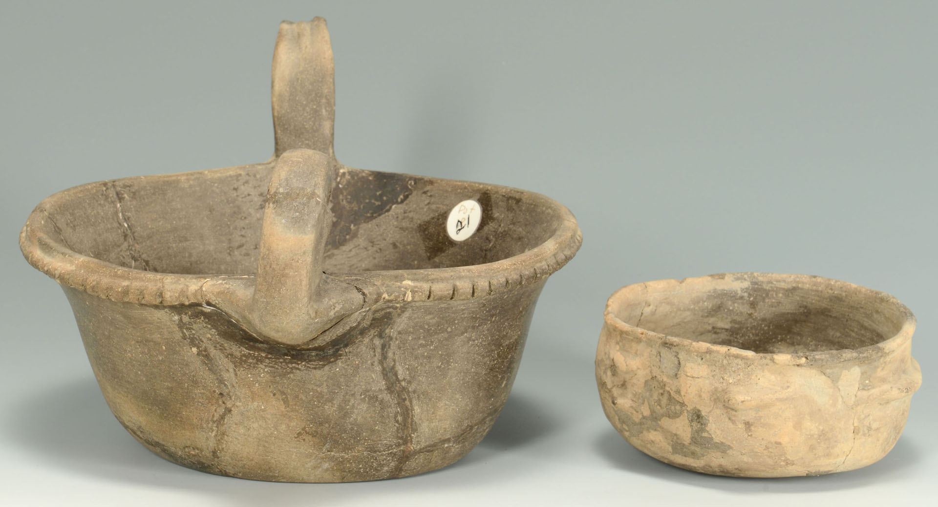 Lot 644: 2 Mississippian Greyware Bowls with Effigy Designs