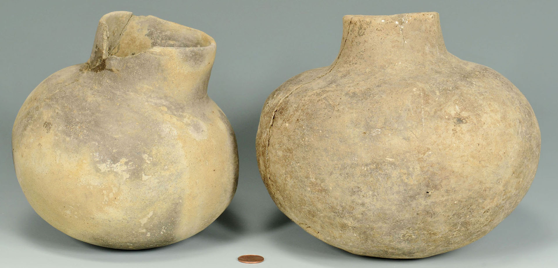 Lot 647: 2 Mississippian Greyware Pottery Water Bottles