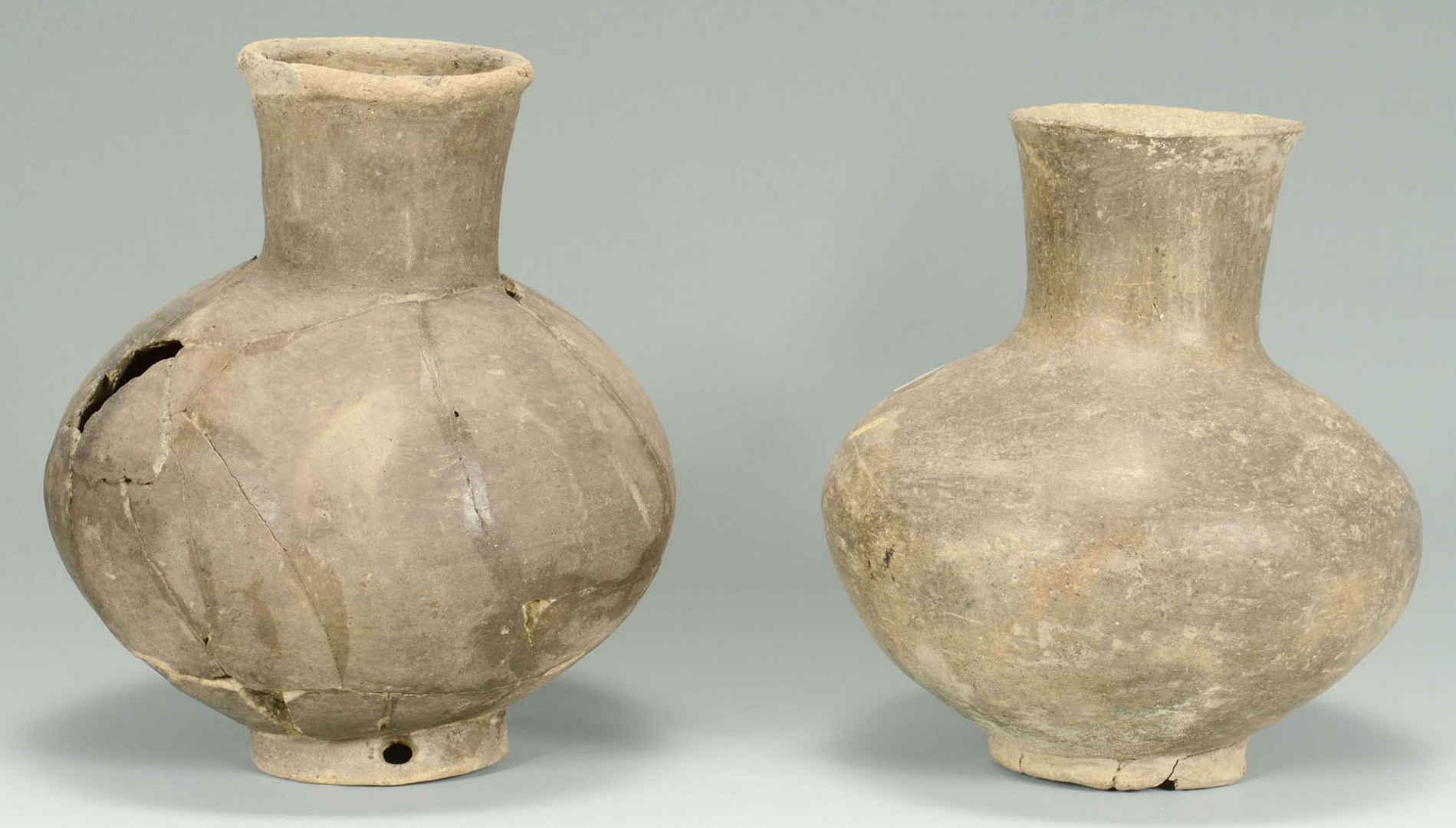 Lot 648: 2 Mississippian Greyware Pottery Bottles on Bases