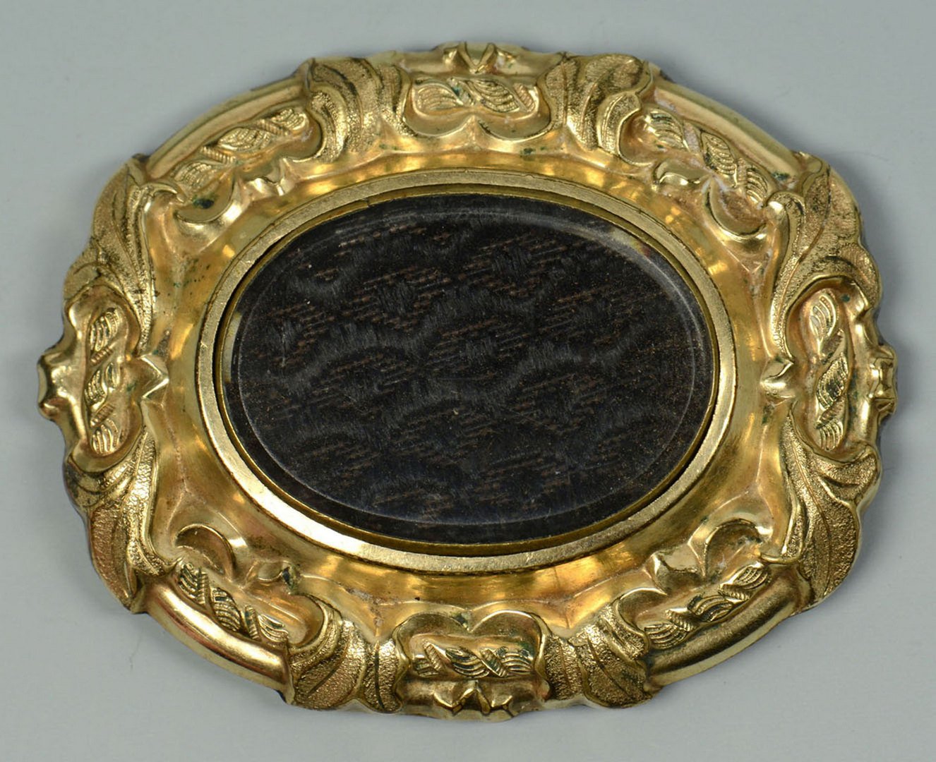 Lot 719: 2 Mourning Brooches , one 14k with child in casket