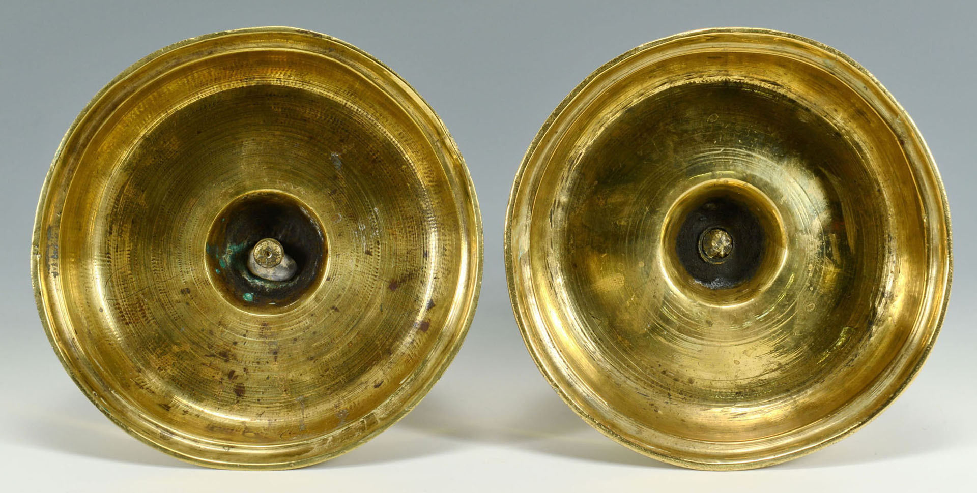 Lot 91: Four 17th century Brass Candlesticks
