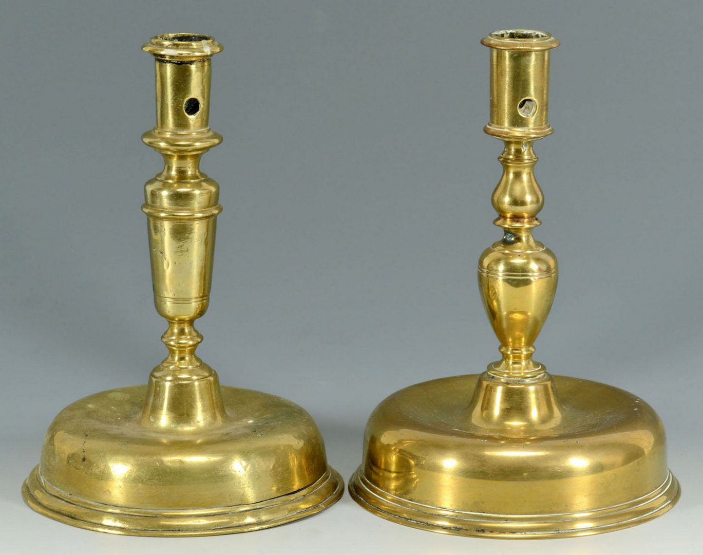 Lot 91: Four 17th century Brass Candlesticks