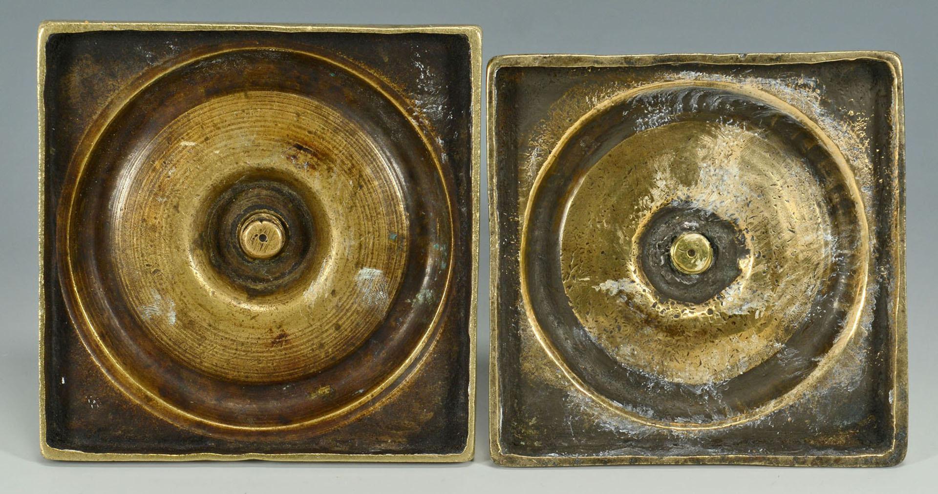 Lot 94: Four English Brass Candlesticks