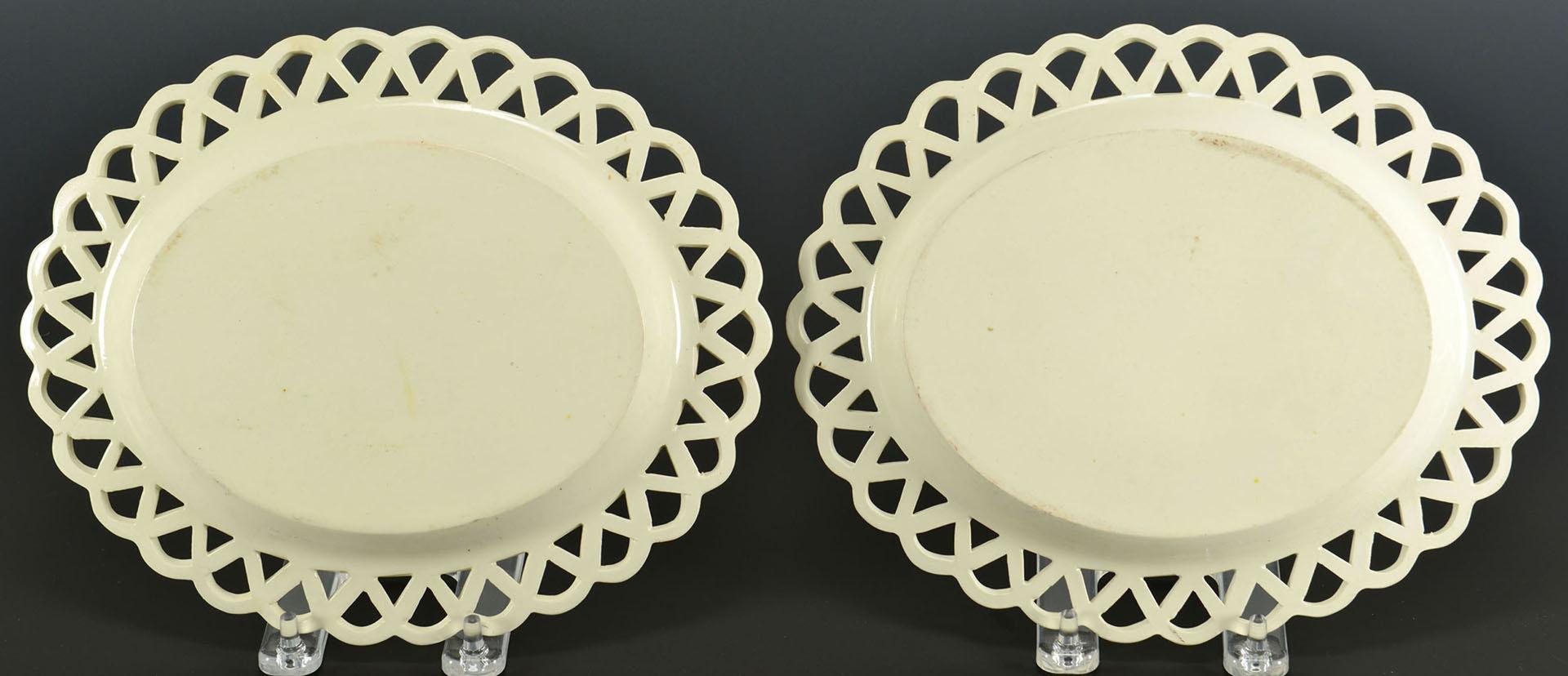 Lot 97: Pr polychrome creamware baskets, underplates