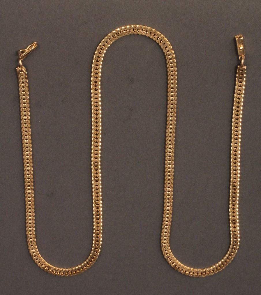 "Lot 104: 14K yellow gold 24"" herringbone necklace"