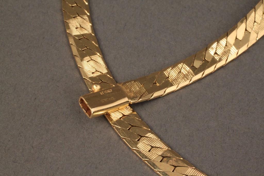 "Lot 111: 14K yellow gold 24"" herringbone necklace"