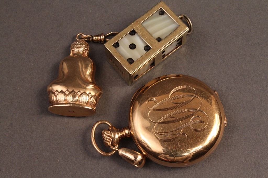 Lot 114A: 3 gold pendants: Buddha, dice, watch mounting