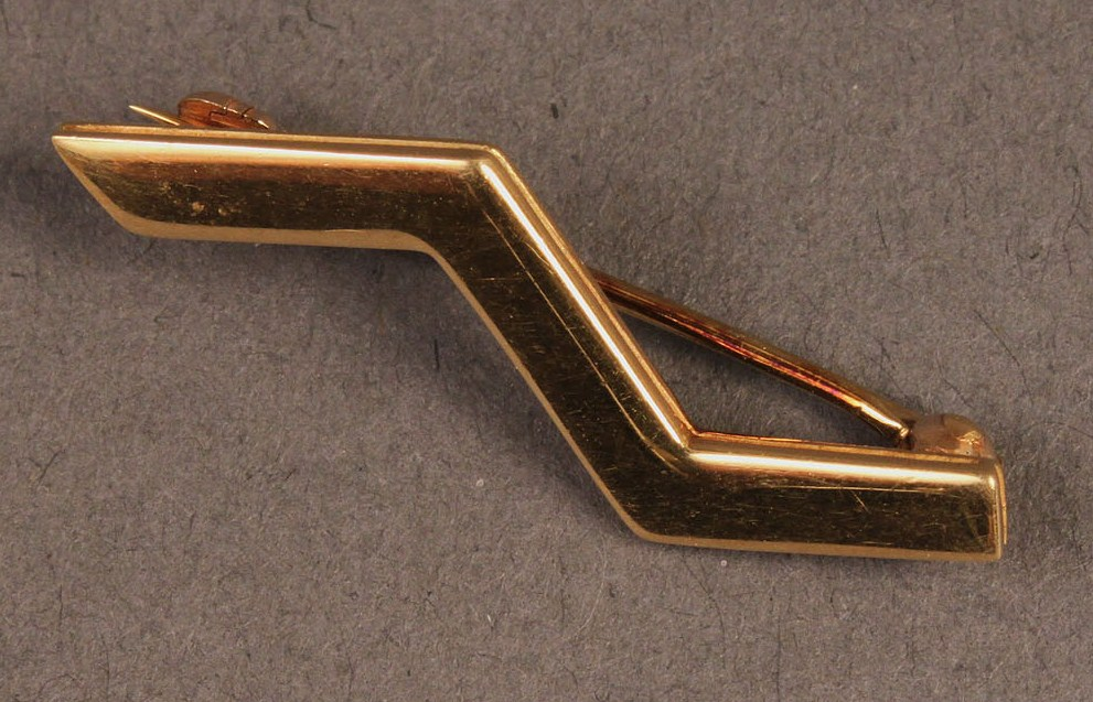 Lot 234: Lot of two gold pins, Tiffany and Lagos