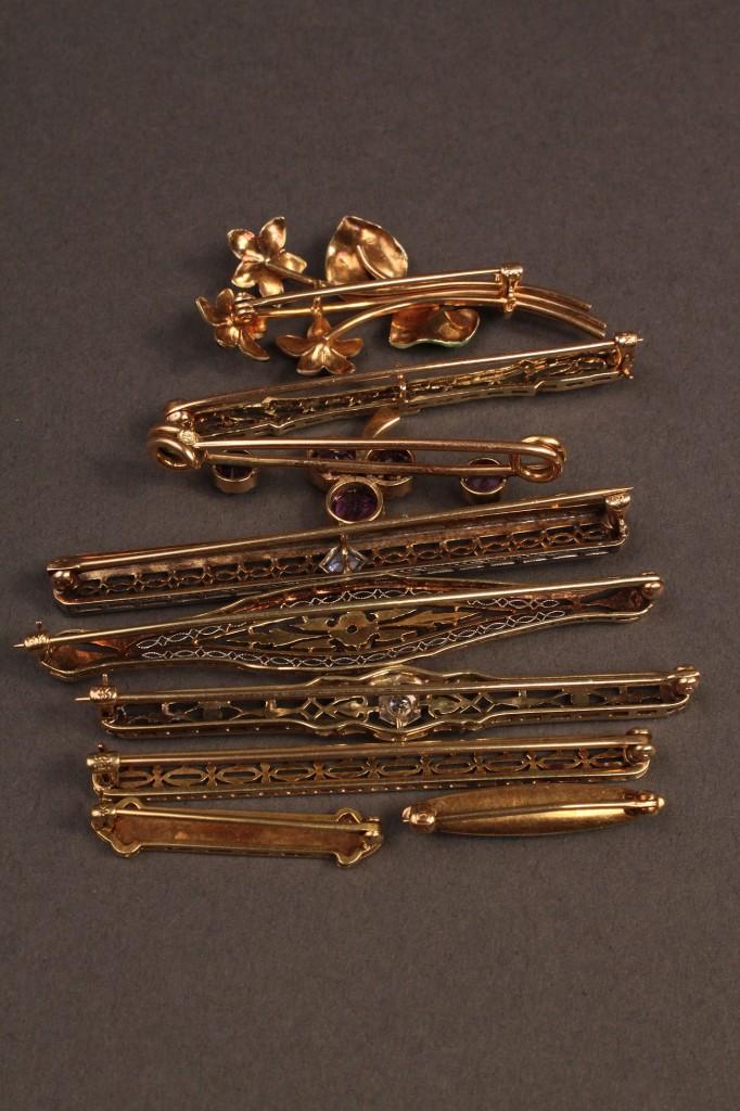 Lot 251: Lot of 9 14K Pins, various stones & enamel