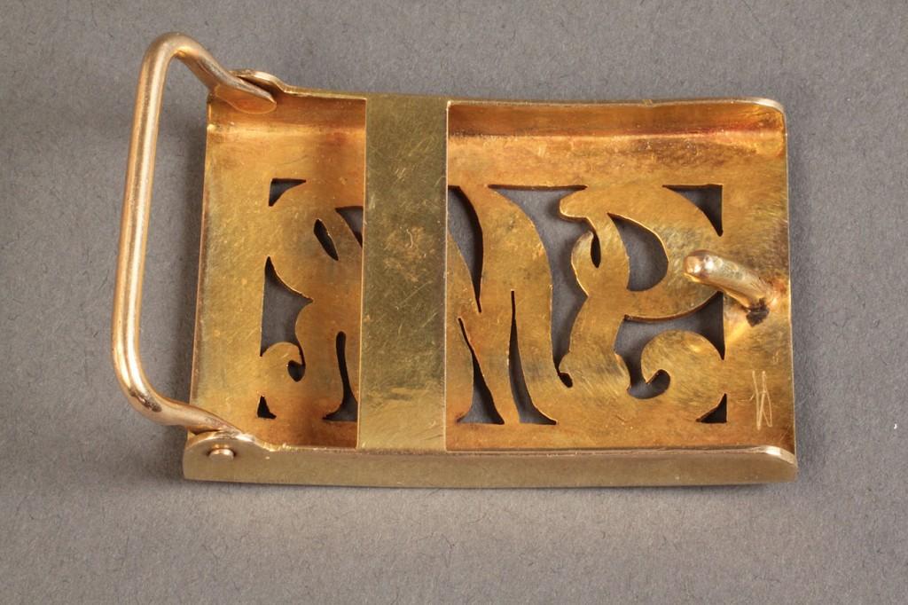 Lot 253: 14K Belt Buckle, monogrammed JMR