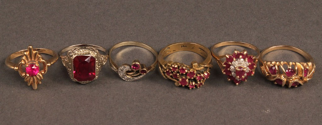Lot 254: Lot of 6 Gold Rings w/ Red Stones