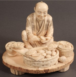 Lot 262: Ivory Japanese figure shucking clams
