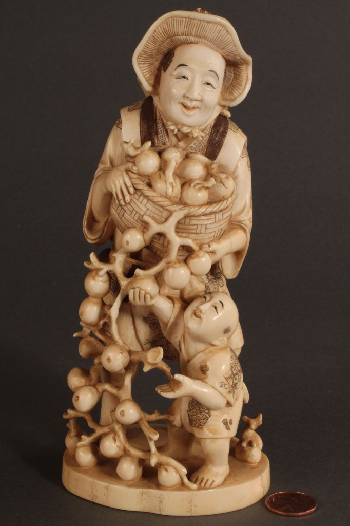 Lot 263: Asian Ivory Figure of Peach Farmer with Child